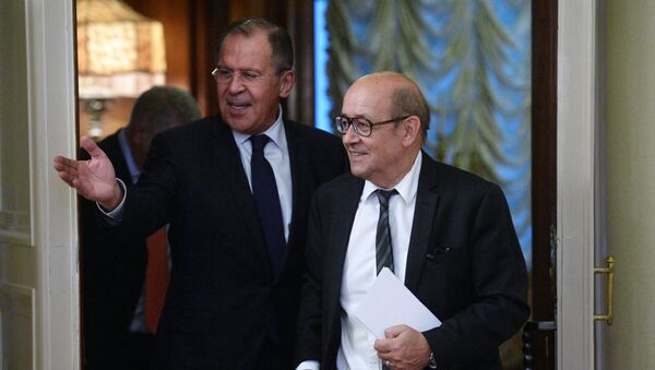 Russian Foreign Minister Sergey Lavrov, left, and Jean-Yves Le Drian, French Minister for Europe and Foreign Affairs, during a meeting at the Russian Foreign Ministry's Reception House - Sputnik International