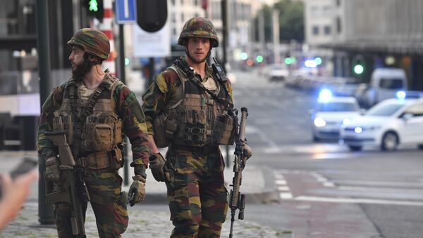 In this image taken from video, police cars create a cordon near the train station in central Brussels, Tuesday June 20, 2017. Belgian media report that explosion-like noises have been heard at a Brussels train station; the main square evacuated. - Sputnik International