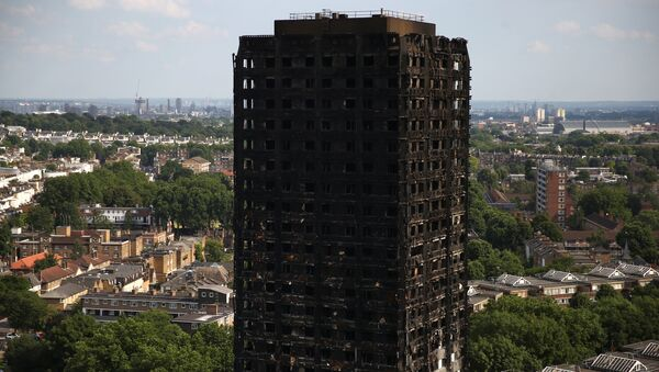 The burnt out remains of the Grenfell apartment tower are seen in North Kensington, London, Britain, June 18, 2017. - Sputnik International