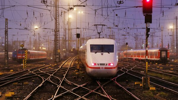 An out-of-service train approaches to a station during a strike by German train drivers to demand pay hike and better work conditions in Frankfurt, Germany, Saturday, Oct. 18, 2014 - Sputnik International