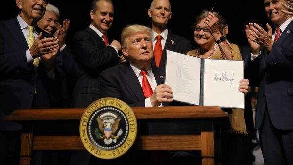 U.S. President Donald Trump is applauded after signing an Executive Order on US-Cuba policy at the Manuel Artime Theater in Miami, Florida, U.S., June 16, 2017 - Sputnik International