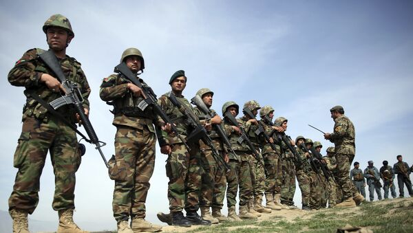 In this Tuesday, Mar. 15, 2016 file photo, Afghanistan's National Army soldiers stand guard, following weeks of heavy clashes to recapture the area from Taliban militants in Dand-e Ghouri district in Baghlan province, north of Kabul, Afghanistan - Sputnik International