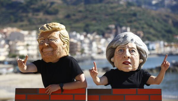 Protesters wear masks depicting U.S. President Donald Trump and Britain's Prime Minister Theresa May during a demonstration against a G7 summit organised by Oxfam in Giardini Naxos near Taormina, Sicily, Italy, May 27, 2017. - Sputnik International