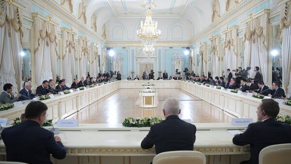 June 1, 2017. Russian President Vladimir Putin meets with activists of the international expert council of the Russian Direct Investment Fund and representatives of the international investment community in the Constantine Palace in Strelna at the 2017 St. Petersburg International Economic Forum - Sputnik International