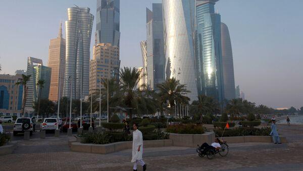 A man walks on the corniche in Doha, Qatar, June 15, 2017 - Sputnik International