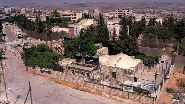 Joseph's Tomb compound is seen from a building in the West Bank city of Nablus. (File) - Sputnik International