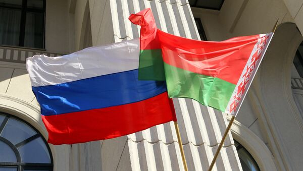 State colors of Russia and Belarus on the building of the Minsk Philharmonic. - Sputnik International