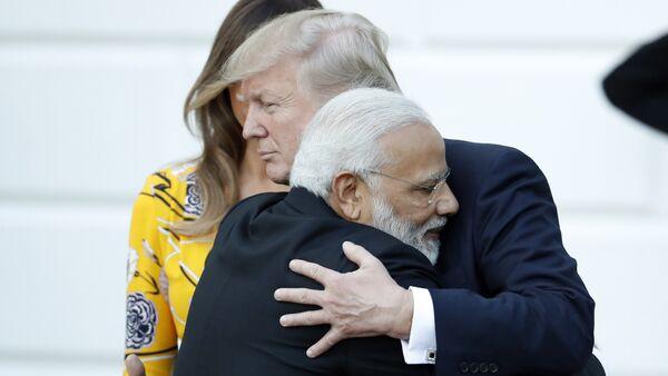 Indian Prime Minister Narendra Modi hugs President Donald Trump as Modi departs the White House, Monday, June 26, 2017, in Washington. - Sputnik International