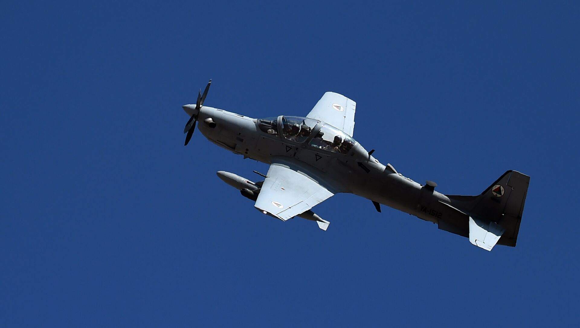 In this photograph taken on October 18, 2016, an Afghan Air Force Embraer A-29 Super Tucano aircraft flies during an airstrike training mission on the outskirts of Logar province - Sputnik International, 1920, 16.08.2021