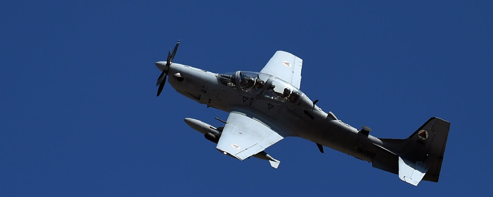 In this photograph taken on October 18, 2016, an Afghan Air Force Embraer A-29 Super Tucano aircraft flies during an airstrike training mission on the outskirts of Logar province - Sputnik International, 1920