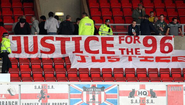 Liverpool fans place a banner about the Hillsborough justice campaign ahead of the English Premier League soccer match between Sunderland and Liverpool at the Stadium of Light, Sunderland, England, Saturday, Sept. 15, 2012. - Sputnik International