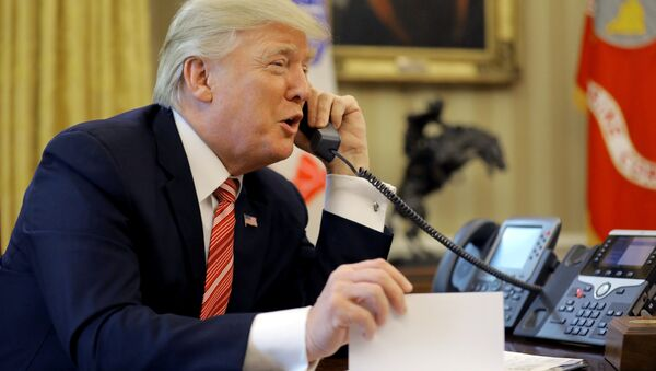 U.S. President Donald Trump congratulates Prime Minister Leo Varadkar of Ireland, during a phone call at the Oval Office of the White House in Washington, U.S., June 27, 2017 - Sputnik International