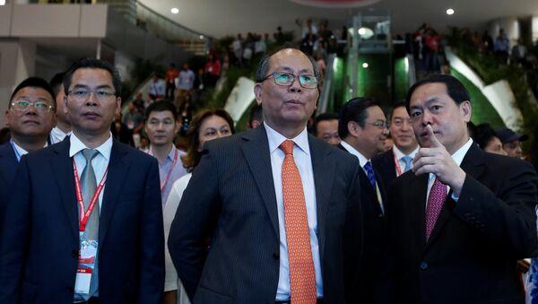 China's Ambassador to Mexico Qiu Xiaoqi listens to Mi Jiao Meng, Mayor of Huizhou City, during the Expo China Homelife Show, a platform for leading Chinese companies seeking to do business in Mexico, in Mexico City, Mexico June 13, 2017 - Sputnik International