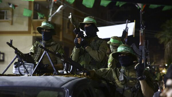 Masked militants from the Izzedine al-Qassam Brigades, a military wing of Hamas, ride vehicles during a rally marking Al-Quds, Jerusalem, Day in Nusseirat refugee camp, in the central Gaza Strip, Friday, June 23, 2017 - Sputnik International