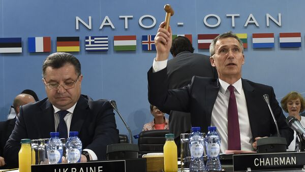 NATO Secretary-General Jens Stoltenberg (R) holds up a gavel, flanked by Ukrainian Minister of Defence and General of the Army Stepan Poltorak, during a NATO-Ukraine Defense Council meeting at the NATO Headquarters in Brussels (File) - Sputnik International