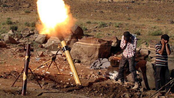 Militants fire mortar shells towards forces loyal to Syria's President Bashar al-Assad in Quneitra province, bordering the Israeli-occupied Golan Heights, Syria June 24, 2017 - Sputnik International