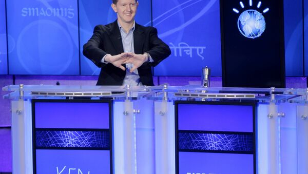 Jeopardy! contestant Ken Jennings, who won a record 74 consecutive games, cracks his knuckles before starting a practice match against another Jeopardy! champion and an IBM computer called Watson in Yorktown Heights, N.Y., Thursday, Jan. 13, 2011. It's the size of 10 refrigerators, and it swallows encyclopedias whole, but an IBM computer was lacking one thing it needed to battle the greatest champions from the Jeopardy! quiz TV show - it couldn't hit a buzzer. - Sputnik International