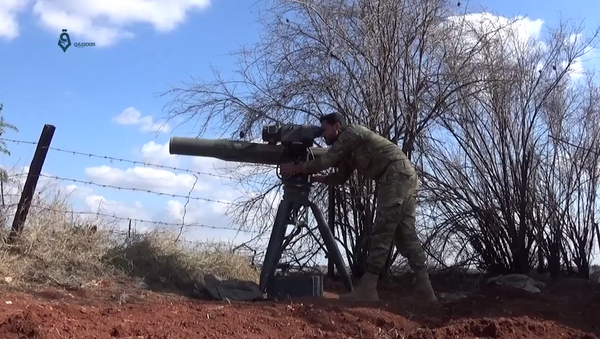 An Army of Glory fighter launches a BGM-71 TOW anti-tank missile at a Syrian government position during the 2017 Hama offensive. - Sputnik International