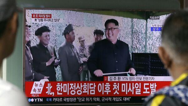 A TV news program shows a file image of North Korean leader Kim Jong Un, at Seoul Railway Station in Seoul, South Korea. in Seoul, South Korea, Tuesday, July 4, 2017. - Sputnik International