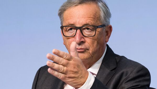 European Commission President Jean-Claude Juncker gestures during a plenary session of European Economic and Social Committee at the EU Charlemagne building in Brussels on Thursday, Sept. 22, 2016. - Sputnik International