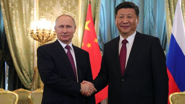 July 4, 2017. From left: Russian President Vladimir Putin meets with People's Republic of China President Xi Jinping in Moscow. - Sputnik International