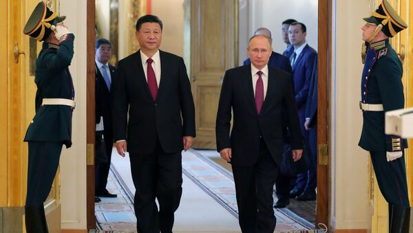 July 4, 2017. From right: Russian President Vladimir Putin meets with People's Republic of China President Xi Jinping in Moscow. - Sputnik International