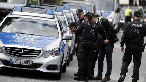 Police officers gather around the fair halls for the upcoming G-20 summit in Hamburg, Germany - Sputnik International