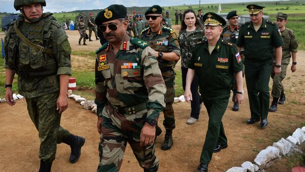 Army General of the Indian Armed Forces Durga Prasad Nudurupati (second left), Deputy Commander of the troops of the Eastern Military District Lt-Gen Sergei Solomatin (center) and Acting Commander of the 5th Combined-Arms Army Major General Roman Kutuzov (second right) visit the Sergeyevsky testing grounds in the Primorye Territory during preparations for the Indra-2017 Russian-Indian military exercises - Sputnik International