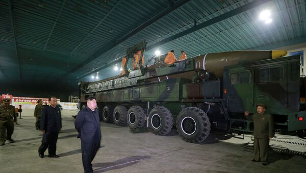 North Korean leader Kim Jong Un inspects the intercontinental ballistic missile Hwasong-14 in this undated photo released by North Korea's Korean Central News Agency (KCNA) in Pyongyang July 5, 2017. - Sputnik International