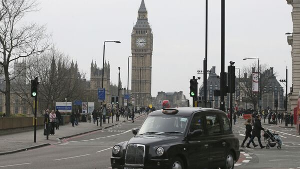 A black cab drives past as Westminster Bridge is re-opened to the public Thursday, March 23, 2017, following an attack on Wednesday when a man drove a car into pedestrians then stabbed a police officer to death before being fatally shot by police within Parliament's grounds - Sputnik International