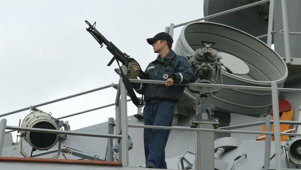 A sailor stands watch onboard the USS LaBoon as the ship sits docked in Philadelphia. (File) - Sputnik International