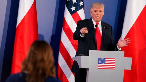 US President Donald Trump gestures during a joint news conference with Polish President Andrzej Duda in Warsaw, Poland July 6, 2017. - Sputnik International