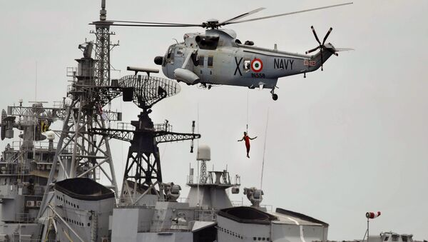 An Indian navy helicopter approaches an Indian navy ship while displaying rescue skills during a joint naval exercise with the Sri Lankan navy in Trincomalee, Sri Lanka (File) - Sputnik International