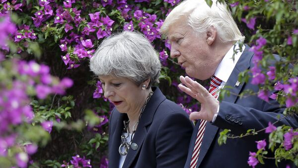 US President Donald Trump, right, talks with British Prime Minister Theresa May in Taormina, Italy, Friday, May 26, 2017. - Sputnik International
