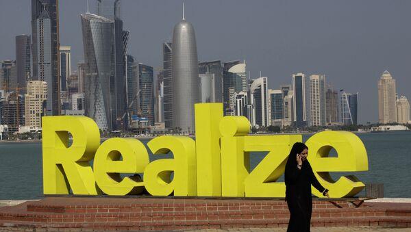 A women walks at the corniche seaside, in Doha, Qatar, on Sunday Jan. 23, 2011. - Sputnik International