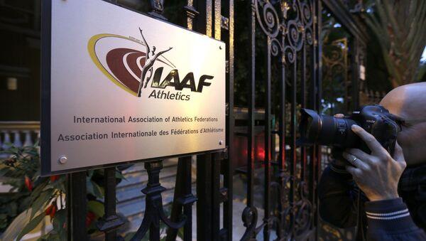 A photographer pictures the logo at the IAAF (International Amateur Athletic Federation) (File) - Sputnik International