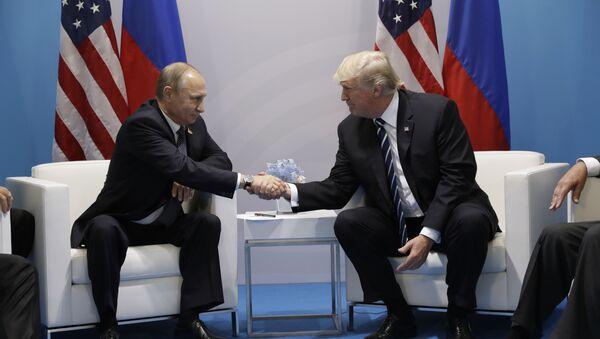 President Donald Trump shakes hands with Russian President Vladimir Putin at the G20 Summit, Friday, July 7, 2017, in Hamburg - Sputnik International