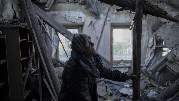 A resident of the village of Staromikhailovka, damaged by a shelling, in the Donetsk region. - Sputnik International