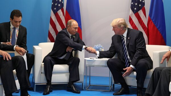 Russian President Vladimir Putin and President of the USA Donald Trump, right, talk during their meeting on the sidelines of the G20 summit in Hamburg - Sputnik International