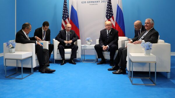 Russian President Vladimir Putin and President of the USA Donald Trump, third right, during their meeting on the sidelines of the G20 summit in Hamburg. Right: US Secretary if State Rex Tillerson; left: Russian Foreign Minister Sergei Lavrov. - Sputnik International
