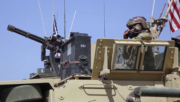 This Saturday, April. 29, 2017 still taken from video, shows an American soldier looking out of an armored vehicle in the northern village of Darbasiyah, Syria - Sputnik International