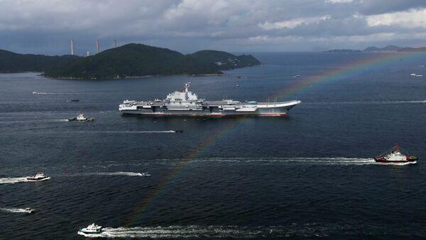 China's aircraft carrier Liaoning sails past a rainbow as it enters Hong Kong, China, July 7, 2017 - Sputnik International