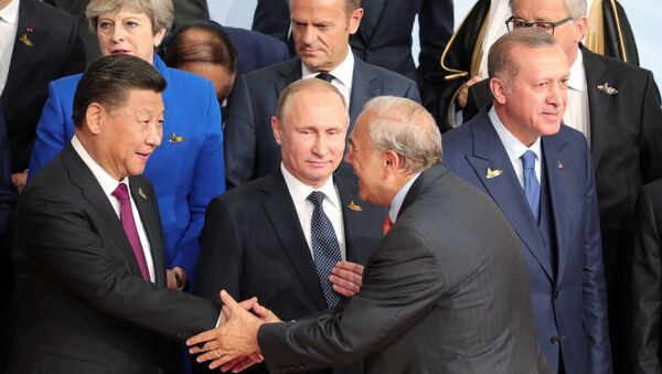 July 7, 2017. Russian President Vladimir Putin during a group photo session of the G20 heads of state, invited countries and international organizations in Hamburg. At left in the foreground: Chinese President Xi Jinping; right: President of Turkey Recep Tayyip Erdogan - Sputnik International