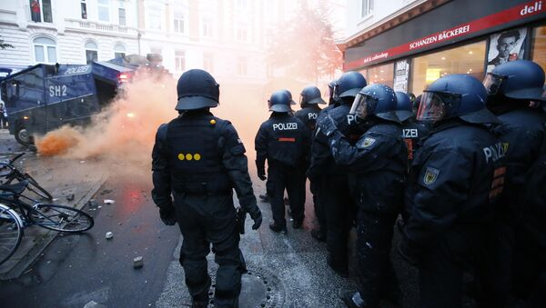German riot police stand to guard protests during the G20 summit in Hamburg, Germany, July 7, 2017 - Sputnik International