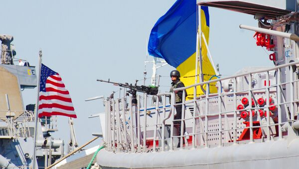 The Ukrainian Navy Hetman Sahaidachnyi frigate (R) and United States Navy missile destroyer Donald Cook (DDG-75) are moored near one another during the international drill Sea Breeze-2015 which officially begins in southern Ukrainian city of Odessa, on September 1, 2015. - Sputnik International