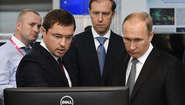 July 10, 2017. Russian President Vladimir Putin looks at Rostec Corporation's display during the 8th Innoprom International Industrial Trade Fair at the Yekaterinburg Expo International Exhibition Center. From left: Rostec Director for Special Commissions Vasily Brovko with Russian Minister of Industry and Trade Denis Manturov. - Sputnik International
