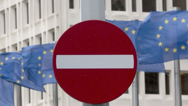 EU flags flap in the wind behind a no entry traffic sign in front of EU headquarters in Brussels. - Sputnik International