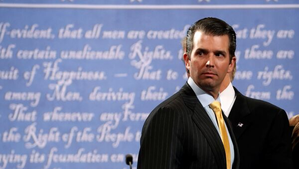 Donald Trump Jr. stands onstage with his father Republican U.S. presidential nominee Donald Trump after Trump's debate against Democratic nominee Hillary Clinton at Hofstra University in Hempstead, New York, U.S. September 26, 2016. - Sputnik International