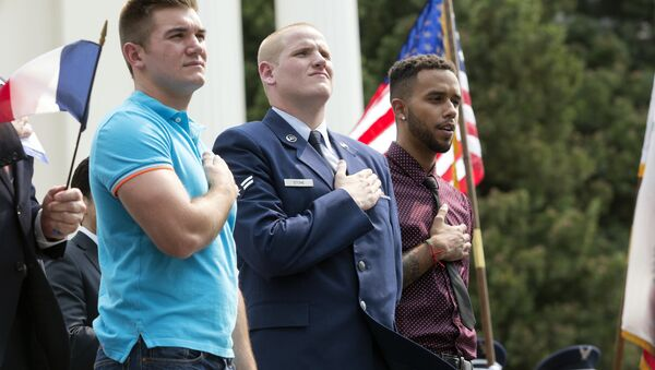 FILE - In this Sept. 11, 2015 file photo, Oregon National Guardsman Alek Skarlatos, left, U.S. Airman Spencer Stone, center, and Anthony Sadler attend a parade held to honor the three Americans who stopped a gunman on a Paris-bound passenger train, in Sacramento, Calif. - Sputnik International