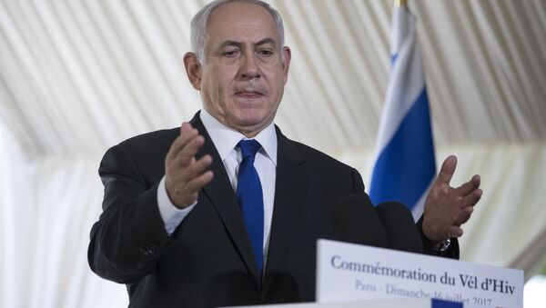 Israeli Prime Minister Benjamin Netanyahu gestures as he delivers a speech during a ceremony commemorating the 75nd anniversary of the Vel d'Hiv roundup, Sunday, July 16, 2017 in Paris - Sputnik International